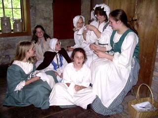 Young Pioneers taking a sewing lesson